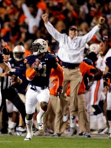 Auburn cornerback Chris Davis (11) returns a missed field goal attempt 100-plus yards to score the game-winning touchdown as time expired in the fourth quarter of an NCAA college football game against No. 1 Alabama. AP Photo/Dave Martin