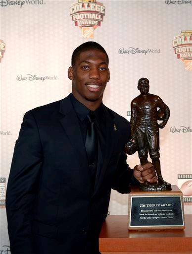 Michigan State defensive back Darqueze Dennard poses with the Jim Thorpe Award after winning the honor during the College Football Awards show in Lake Buena Vista, Fla., Thursday, Dec. 12, 2013.