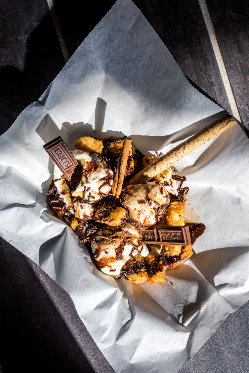Tot Fudge Sundae Totchos: cinnamon sugar tossed tots with three scoops of ice cream and topped with caramel and chocolate drizzle / Image: Catherine Viox // Published: 10.11.20