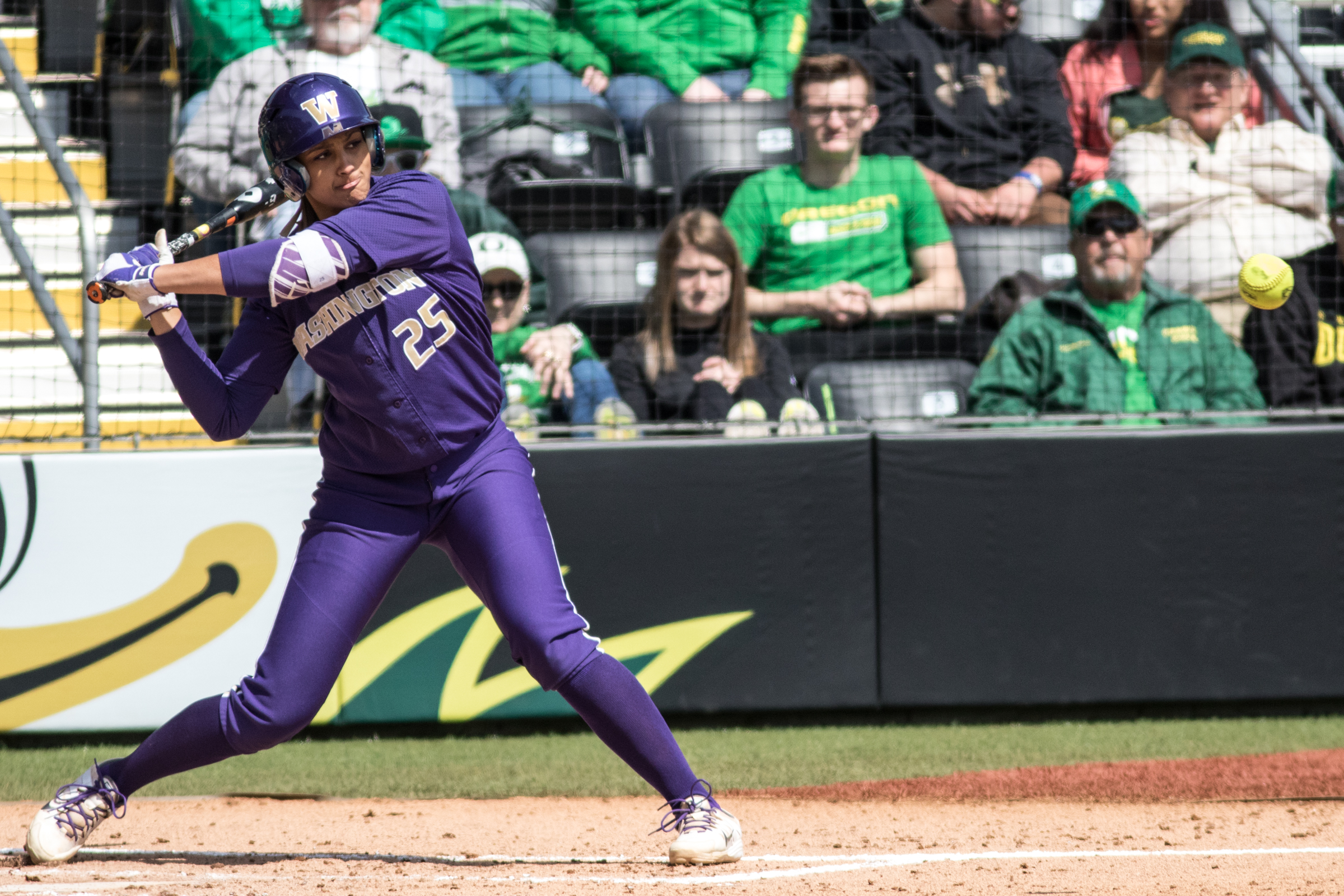 Kirstyn Thomas (#25) waits for the ball to reach her. In the final game of a three-game series, the University of Washington Huskies defeated the Oregon Ducks 5-3.  The Ducks led through the bottom of the 7th inning, but Washington's Morganne Flores (#47) tied it up with a two-run double.  Flores drove in two more runs in the 9th to take the lead.  Photo by Austin Hicks, Oregon News Lab