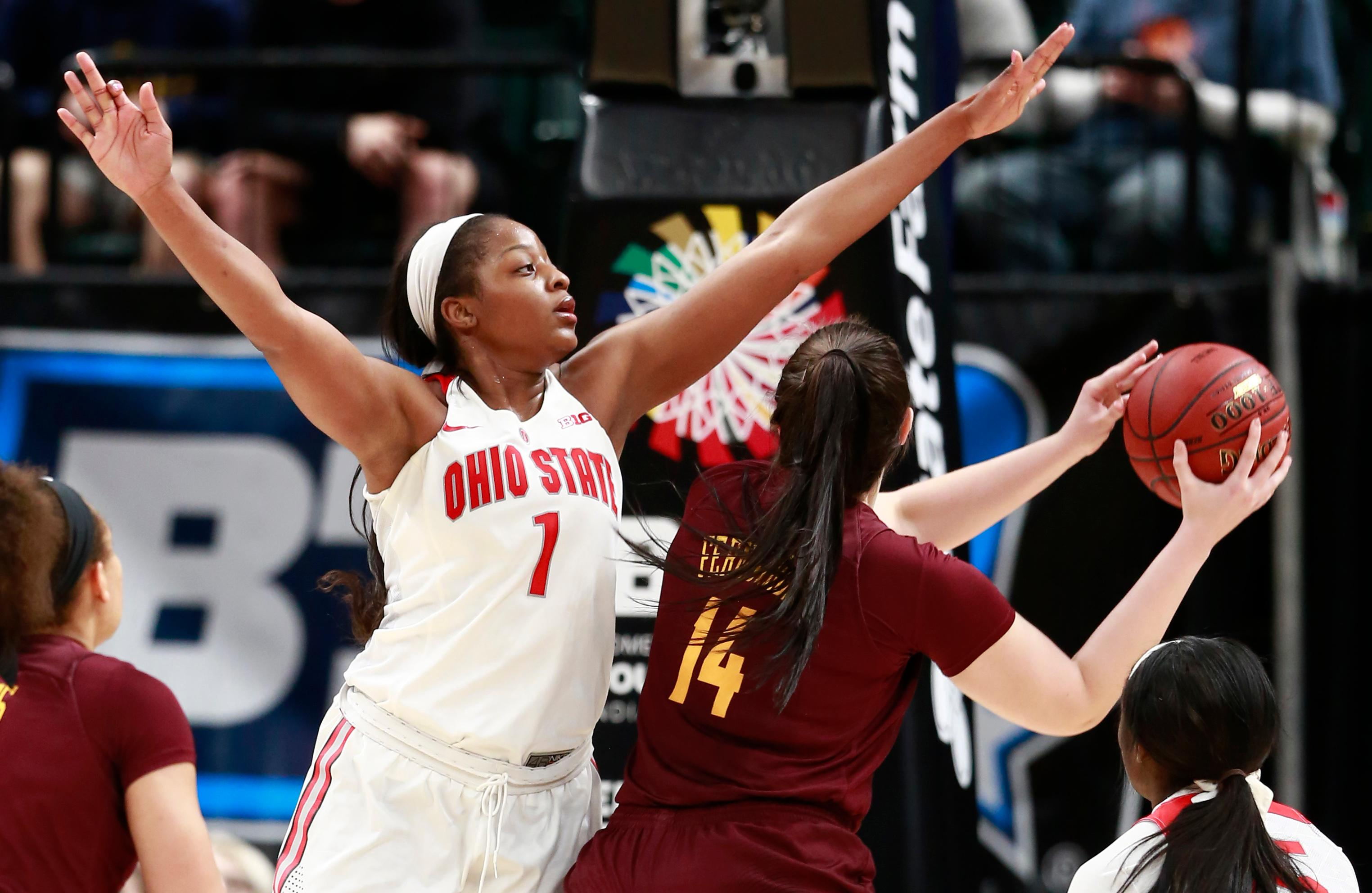 Ohio State forward Stephanie Mavunga (1) defends against Minnesota center Bryanna Fernstrom during the second half of an NCAA college basketball game in the semifinals of the Big Ten women's tournament, Saturday, March 3, 2018, in Indianapolis. Ohio State won 90-88. (AP Photo/R Brent Smith)