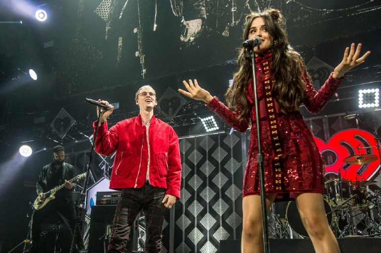 Machine Gun Kelly, left, and Camila Cabello perform at Y100's iHeartRadio Jingle Ball 2016 at BB&T Center on Sunday, Dec. 18, 2016, in Sunrise, Fla. (Photo by Amy Harris/Invision/AP)