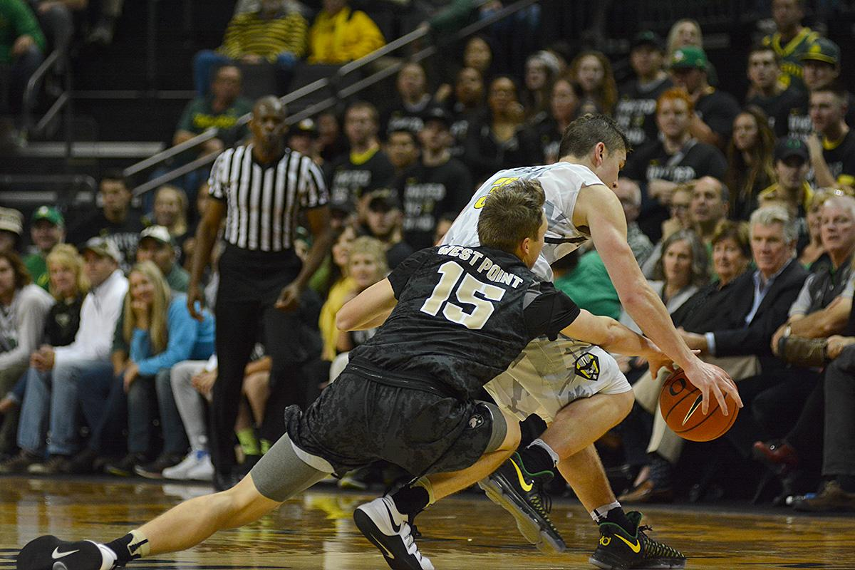 Army's Jacob Kessler (#15) and Ducks' Payton Pritchard (#3) battle over a loose ball. In front of a sold out crowd, Oregon defeated Army 91-77 on opening night. Photo by Jacob Smith, Oregon News Lab