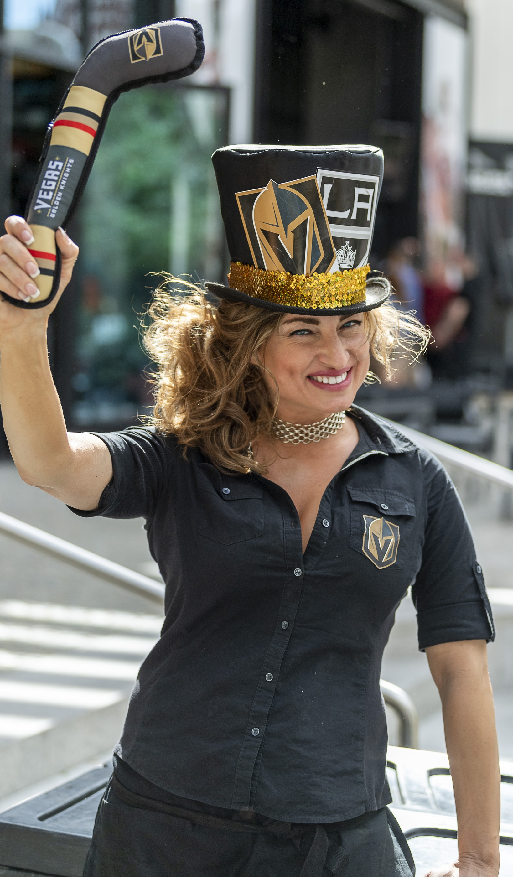 Server Malvina Von Krieger at California Pizza Kitchen in The Park shows her spirit as the Vegas Golden Knights prepare to meet the Los Angeles Kings in the first quarterfinal game of the NHL Stanley Cup Playoffs at T-Mobile Arena in Las Vegas on Wednesday, April 11, 2018.  CREDIT: Mark Damon/Las Vegas News Bureau