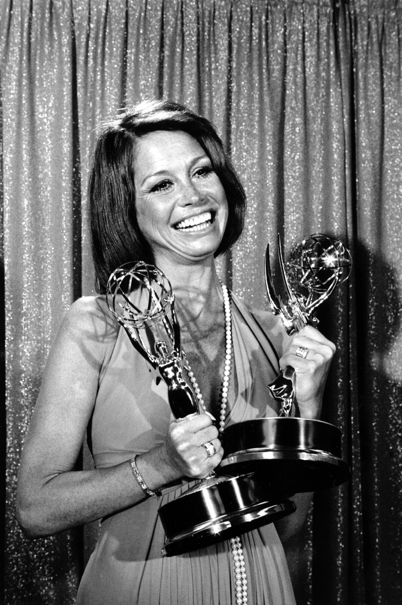 "Mary Tyler Moore holds her Emmys at the 26th Annual Primetime Emmy Awards in Los Angeles, Ca., on May 28, 1974.  Moore won best actress of the year in a comedy series and best actress in a television series for her role in the ""Mary Tyler Moore Show.""  (AP Photo)"