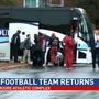 University of Alabama football team returns to Tuscaloosa