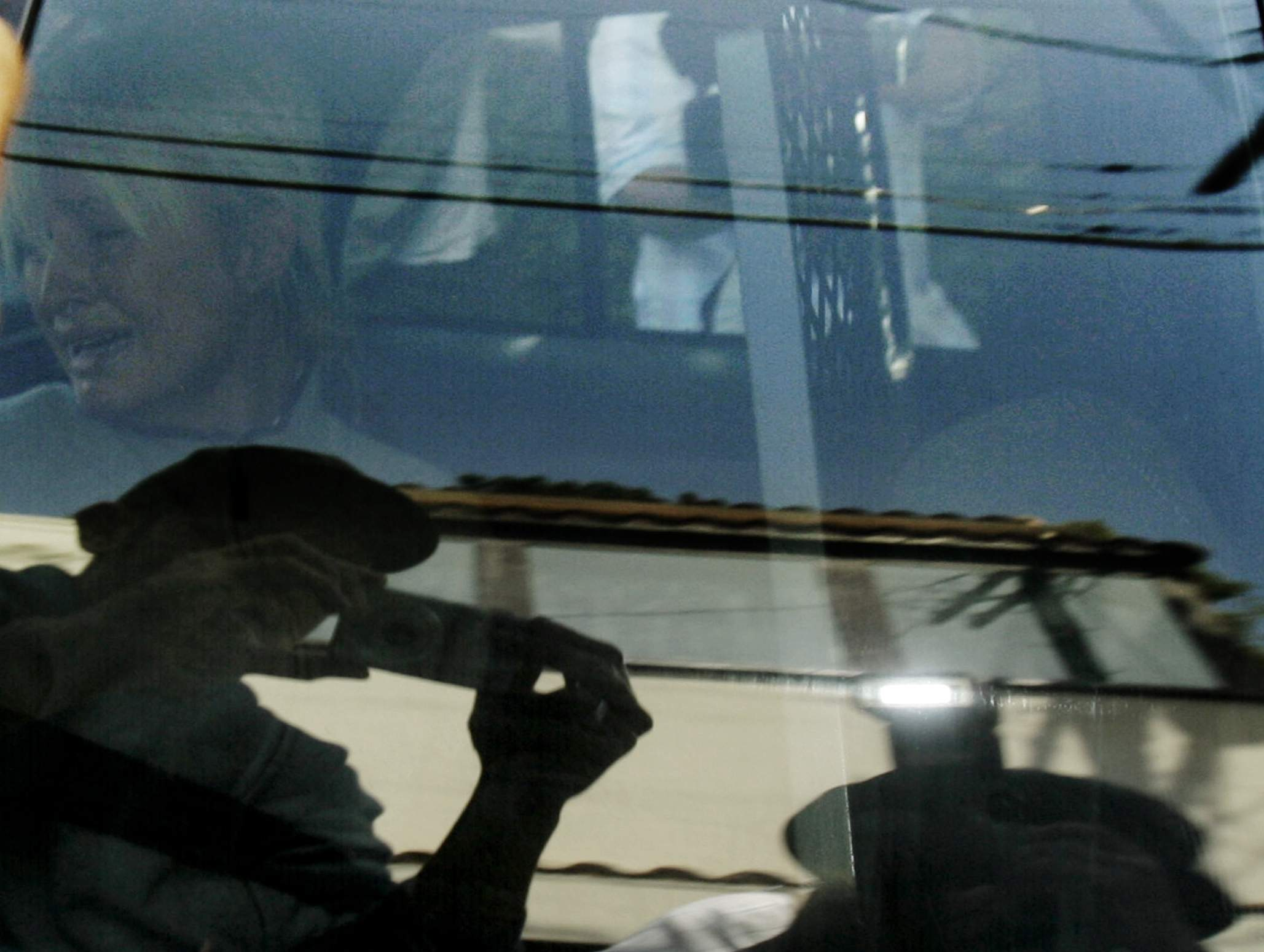In this Friday, June 8, 2007, file photo, Paris Hilton is transported in a police car from her home to court by the Los Angeles County Sheriff's Department in Los Angeles. As she was taken to jail for driving violations, this photo was made on the 35th anniversary of the day Ut made the 'Napalm Girl' picture in Vietnam. NICK UT/THE ASSOCIATED PRESS