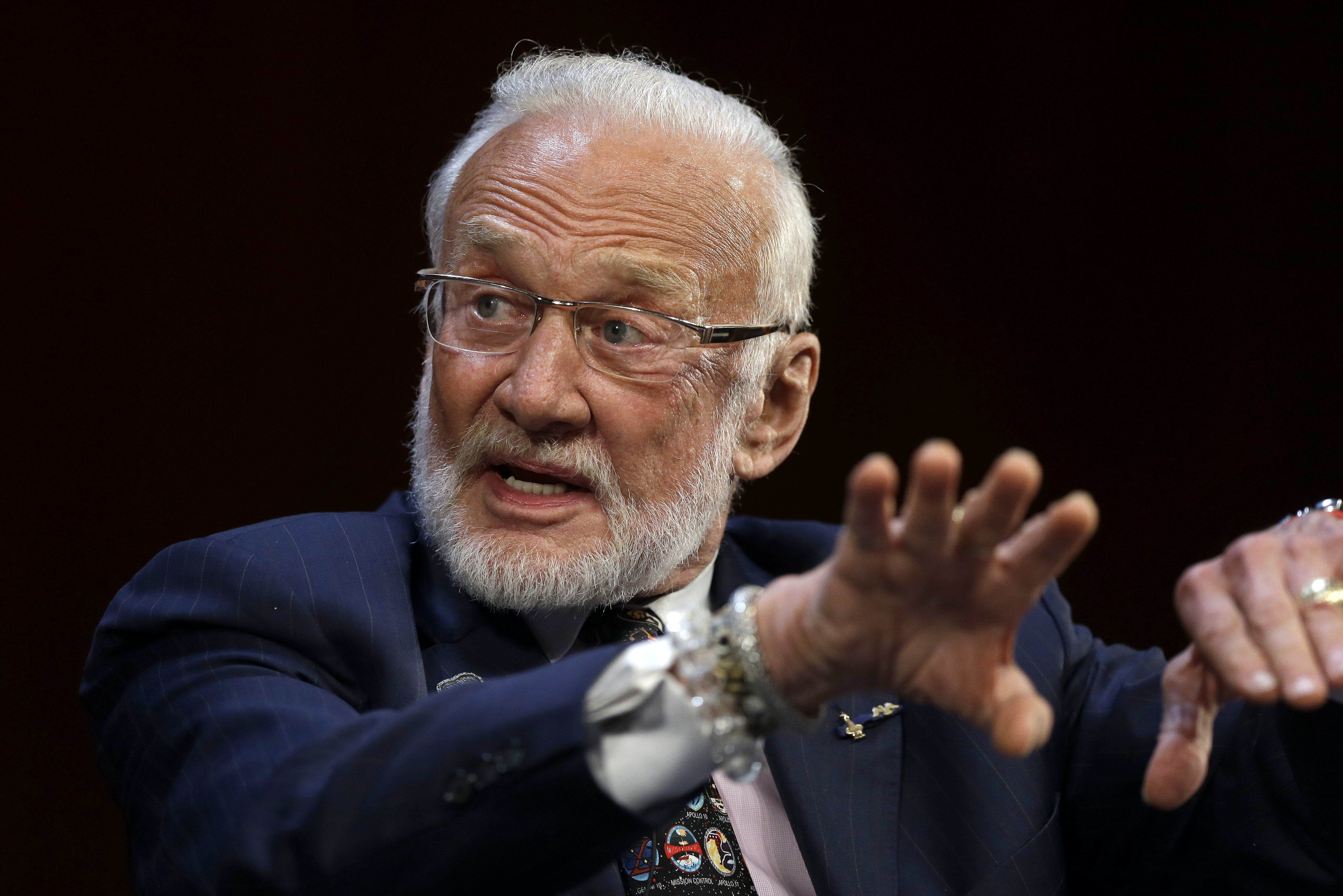 FILE - In this Oct. 22, 2014, file photo, Apollo 11 astronaut Buzz Aldrin, the second person to walk on the Moon, speaks on the campus of Massachusetts Institute of Technology in Cambridge, Mass. Aldrin is hosting a gala for his nonprofit space education foundation, ShareSpace Foundation, at the Kennedy Space Center in Cape Canaveral, Fla., on Saturday, July 15, 2017. The event will raise money and commemorate the 48th anniversary of the Apollo 11 mission. (AP Photo/Steven Senne, File)