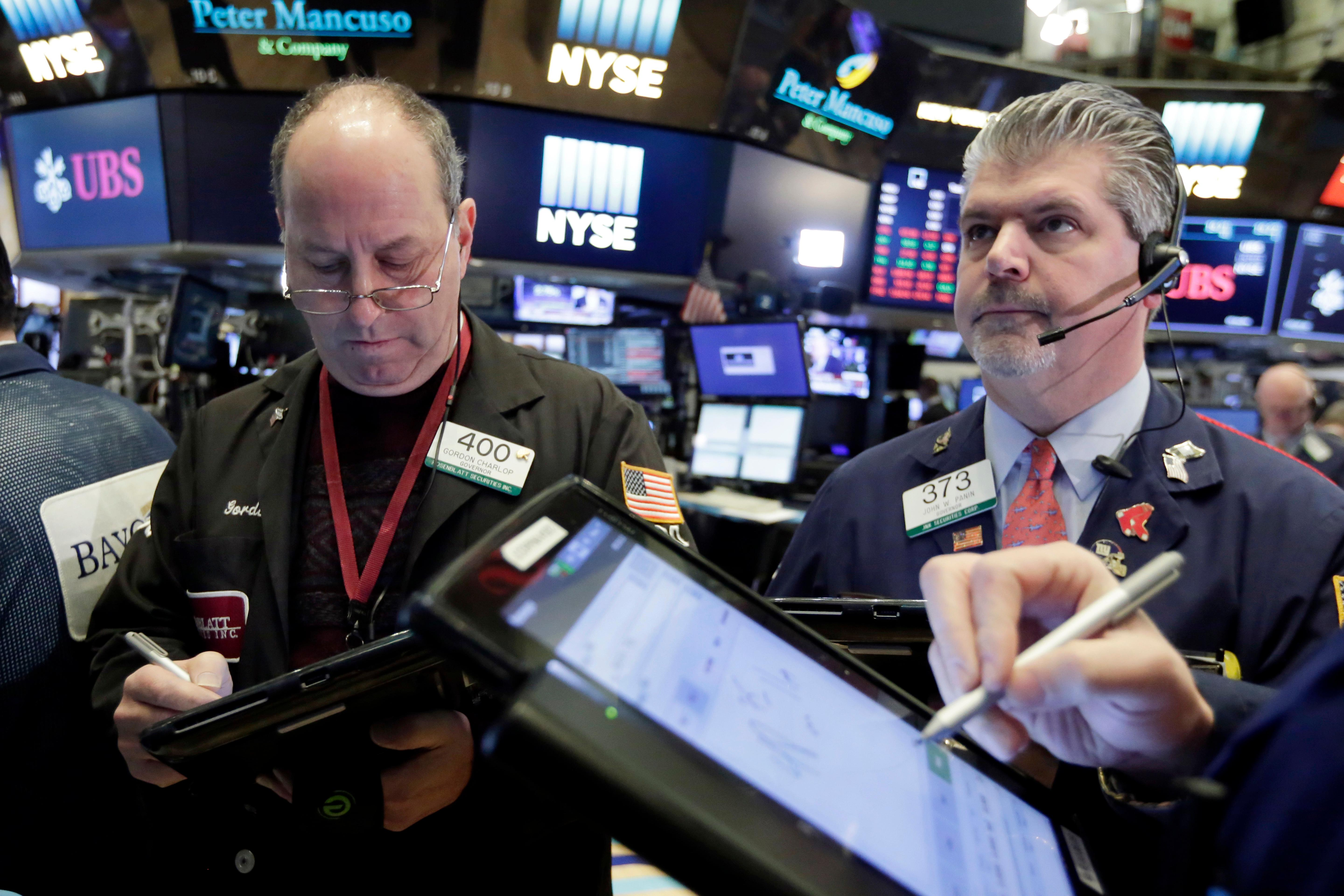 Traders Gordon Charlop, left, and John Panin work on the floor of the New York Stock Exchange, Tuesday, Feb. 6, 2018. The Dow Jones industrial average fell as much as 500 points in early trading, bringing the index down 10 percent from the record high it reached on Jan. 26.{&amp;nbsp;} (AP Photo/Richard Drew)<p></p>