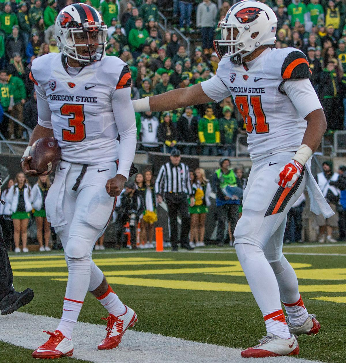 Oregon State Beavers quarterback Marcus McMaryion (#3) celebrates with Noah Togiai (#81) after scoring a touchdown. The Oregon Ducks beat the Oregon State Beavers 52-42 in the 119th Civil War for the eighth year in a row at Autzen Stadium on Friday afternoon. Katie Pietzold, Oregon News Lab