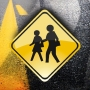 Officials: Kindergartener hit by car while waiting for school bus