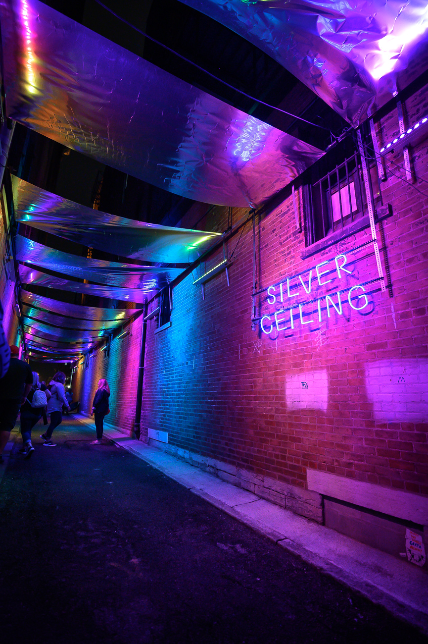 PICTURED NEIGHBORHOOD: Over-the-Rhine / In Michael Bany Way (the alley next to Japp's on Main Street) an awesome installation that involves reflective sheets and neon lights can be seen. / Image: Phil Armstrong // Published: 10.12.19