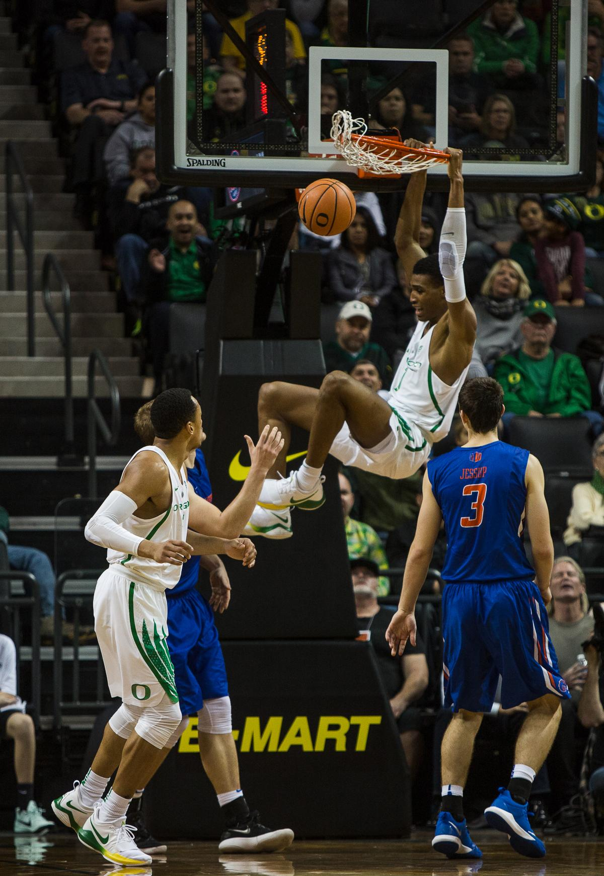 University of Oregon Duck Keith Smith (#11) dunks the ball against Boise State's Justinian Jessup (#3). The Boise State Broncos defeated the University of Oregon Ducks 73 – 70 at Matthew Knight Arena in Eugene, Ore., on December 1, 2017. Photo by Kit MacAvoy, Oregon News Lab