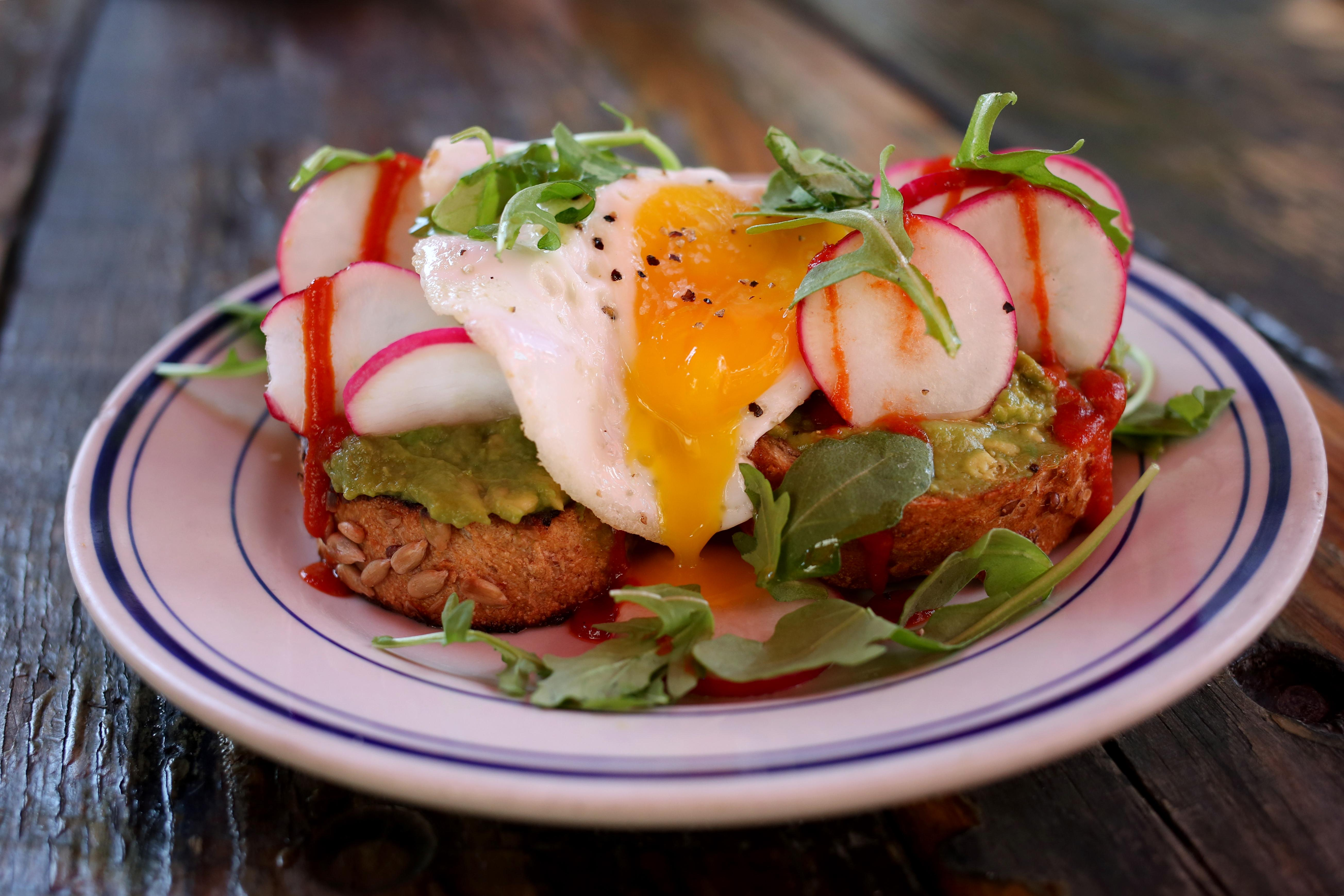 Duke's version of avocado toast comes on multi-grain bread from  Lyon's Bakery, topped with radish, arugula and a runny egg.  The peppery flavors come are nicely complemented by the egg, a common topping in California, and there's plenty of avocado in every bite. (Amanda Andrade-Rhoades/DC Refined)