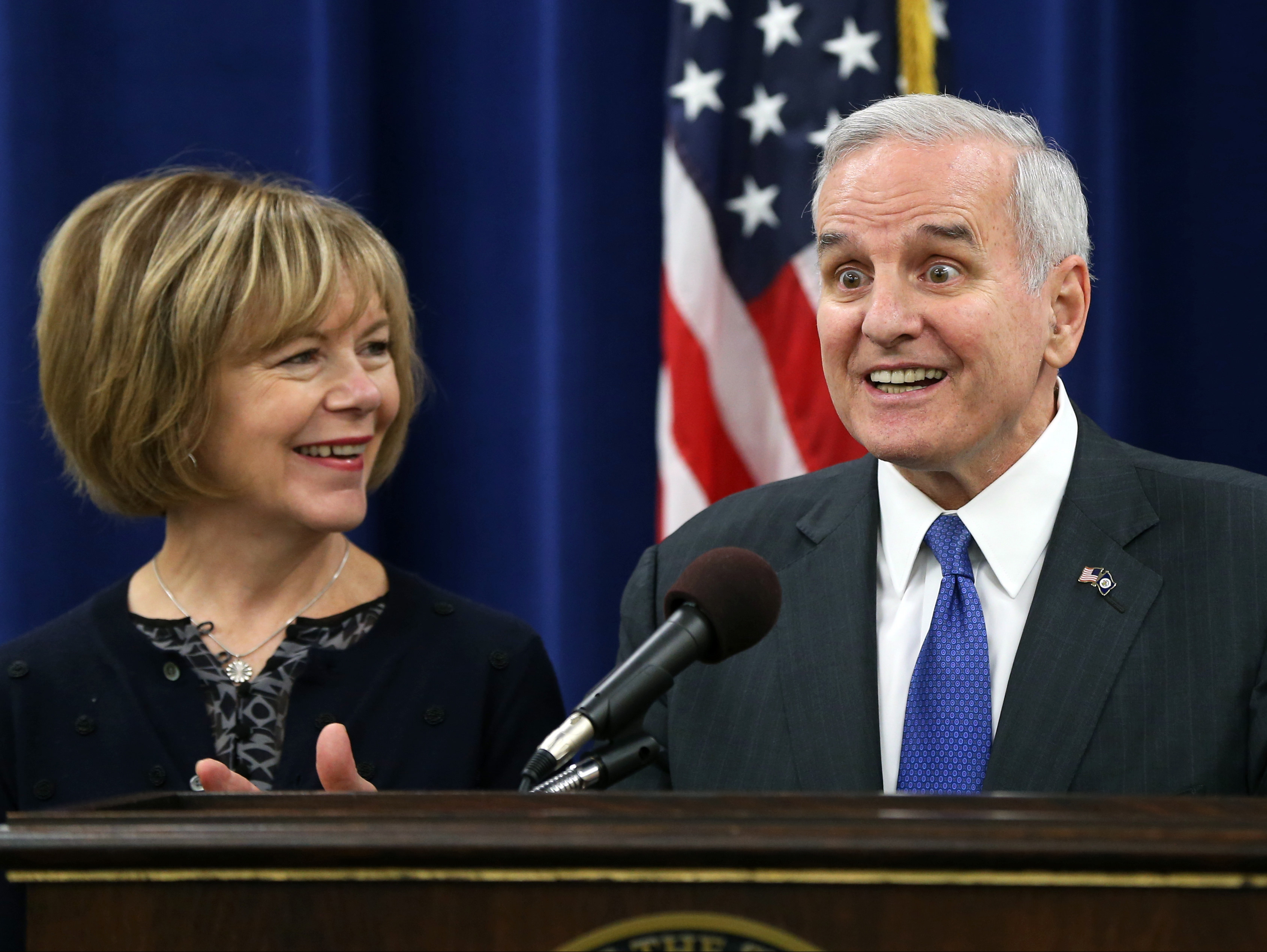 Minnesota Gov. Mark Dayton gets wide-eyed to a question during a press conference Wednesday, Nov. 5, 2014, with running mate Tina Smith in St. Paul, Minn., after winning re-election Tuesday in his race against Republican Jeff Johnson. (AP Photo/Jim Mone)