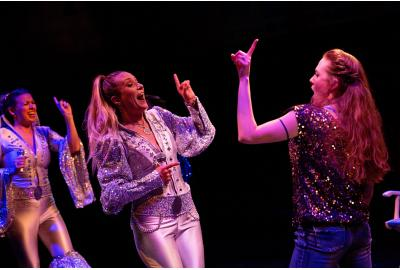 Coby Kay Calahan (Tanya), Heather Beck (Donna) and Maggie Dransfield (Sophie) in MAMMA MIA! at Toby's Dinner Theatre{&amp;nbsp;}(Image: Jeri Tidwell) <p></p>