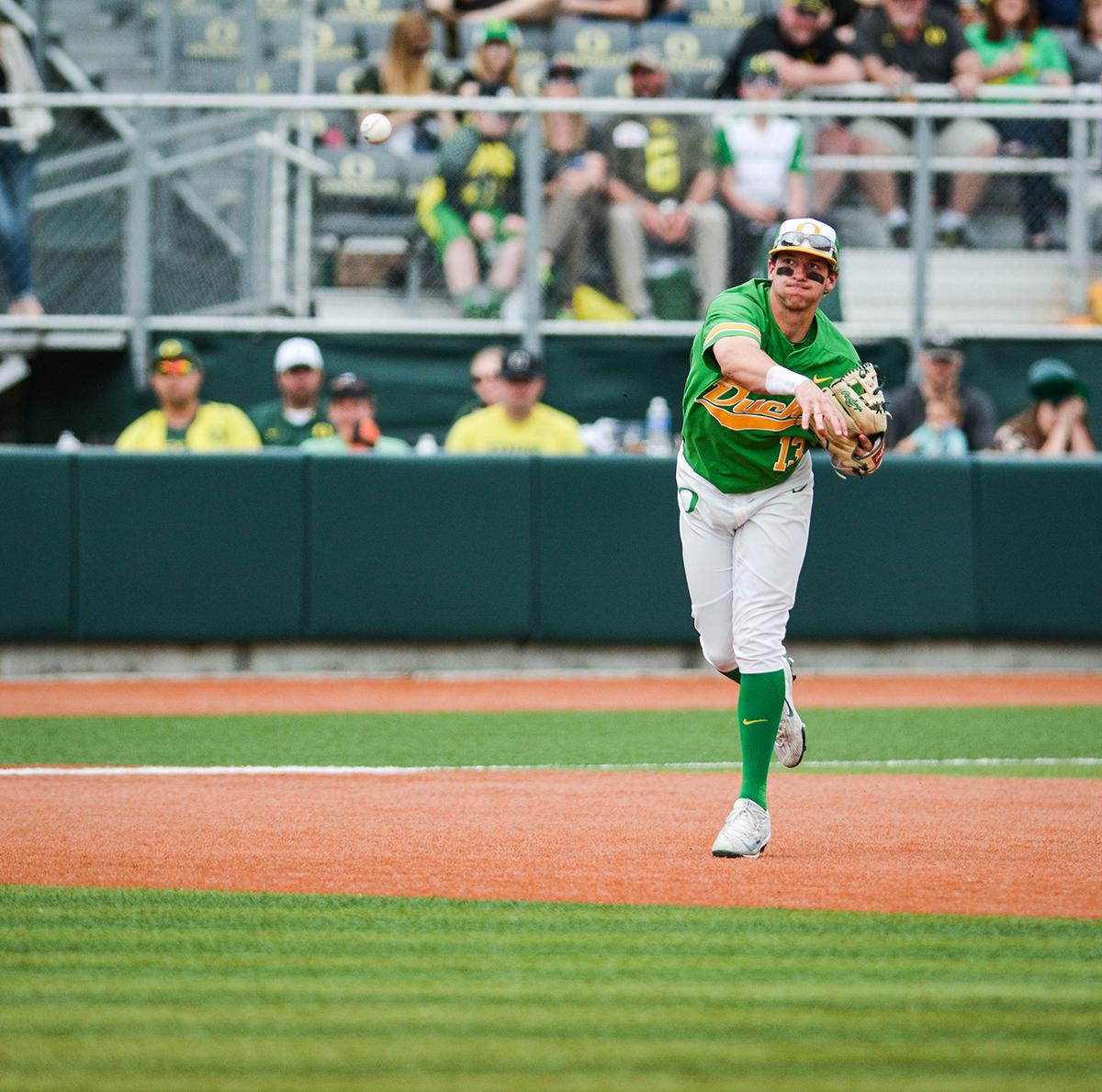 Ducks infielder Spencer Steer (#13) throws the ball to first to try and get the Sun Devils runner out. Despite a late comeback, the Ducks fall to Arizona State Sun Devils 4-3 in the second game of a three-game series. Photo by Jacob Smith, Oregon News Lab