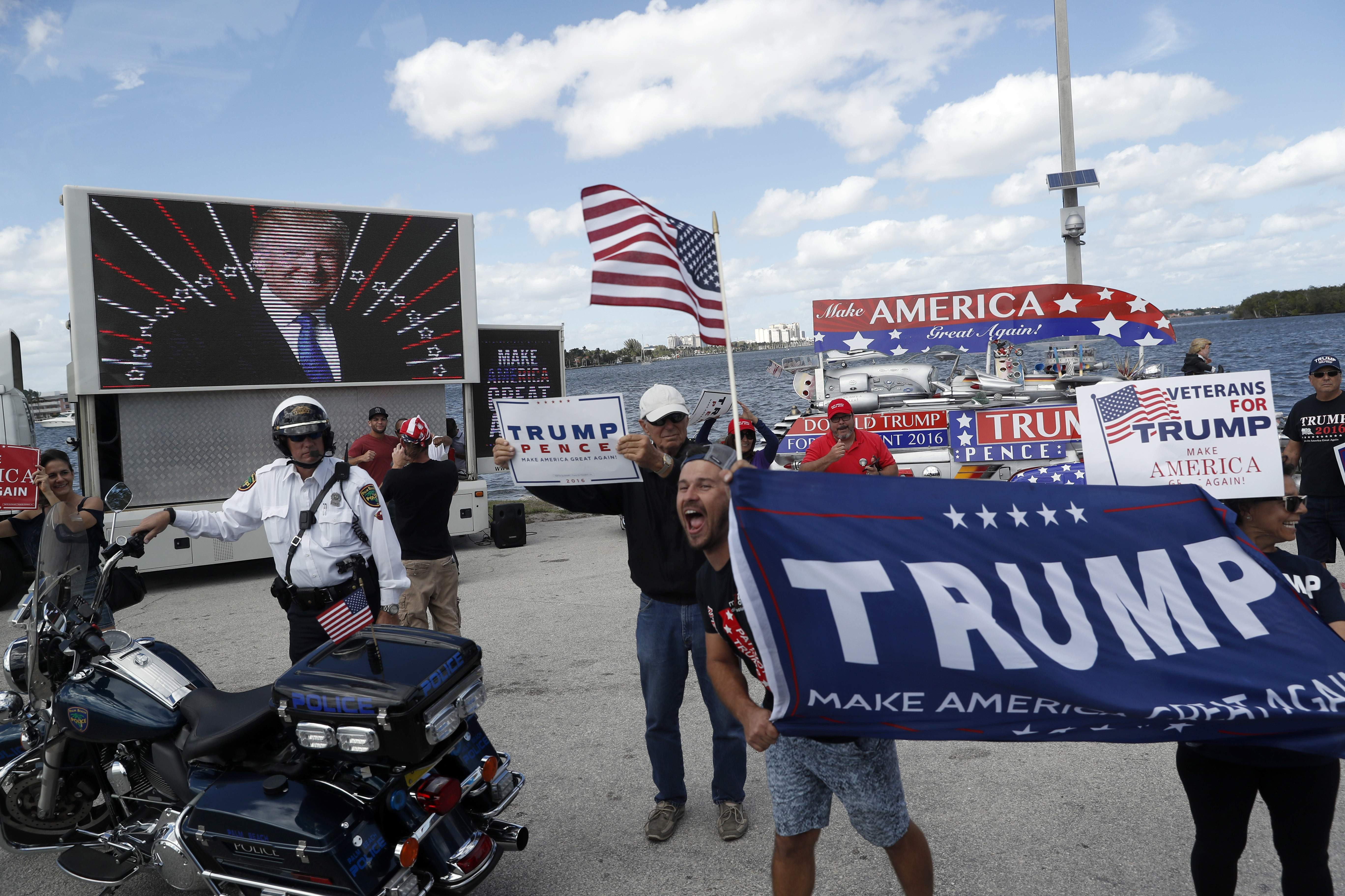 DAY 44 - In this March 4, 2017, file photo supporters of President Donald Trump gather outside Mar-a-Lago in Palm Beach, Fla., where President Donald Trump is spending the weekend. While at Mar-a-Lago, the president did not have any events that were open for media coverage and was not photographed on day 44. (AP Photo/Alex Brandon, File)