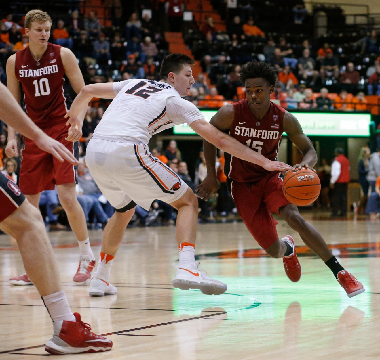 Stanford's Marcus Allen (15) gets around the defense of Oregon State's Drew Eubanks (12) pduring the second half of an NCAA college basketball game in Corvallis, Ore., Thursday, Jan. 19, 2017. Stanford won 62-46. (AP Photo/Timothy J. Gonzalez)