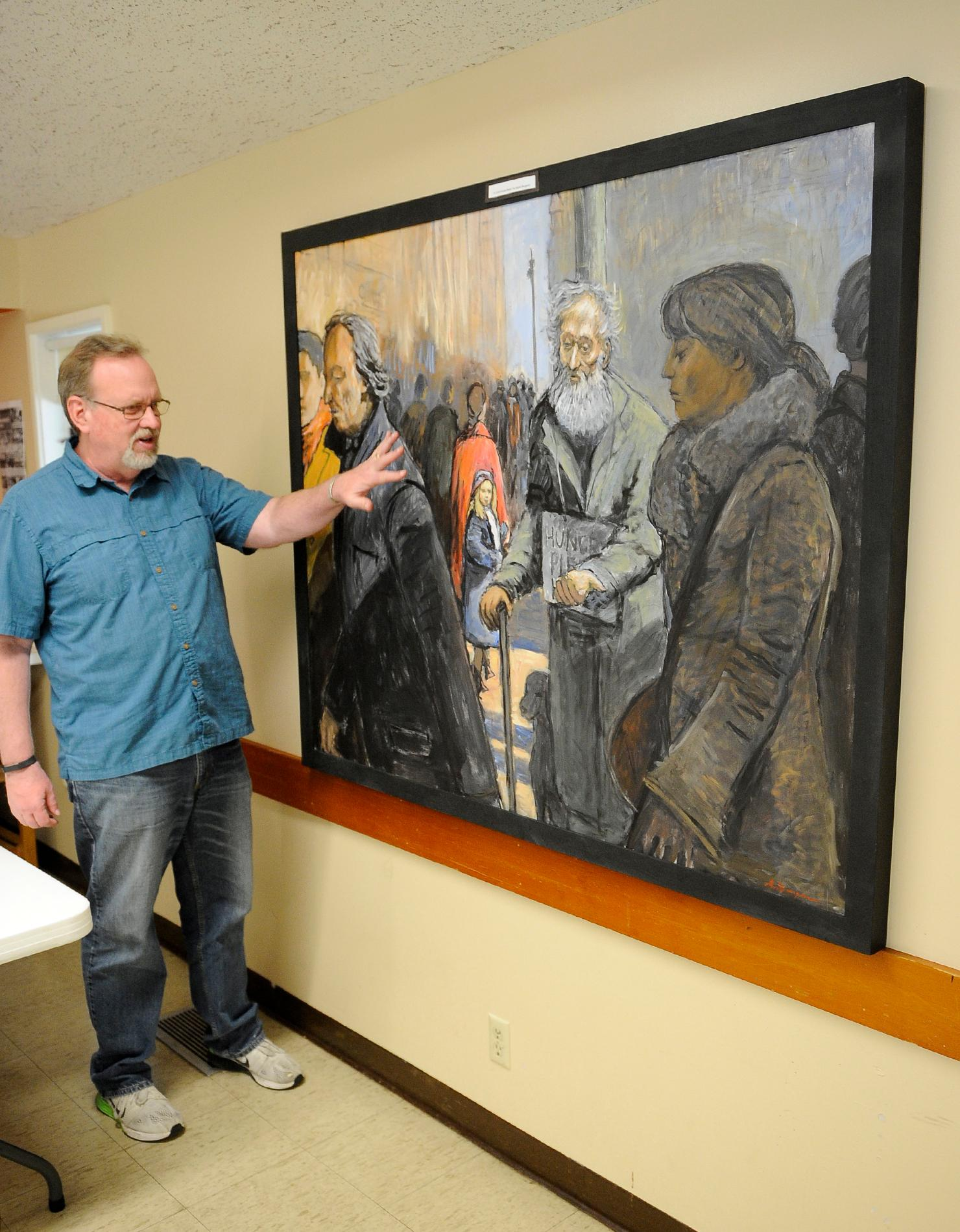 "The Rev. Dan Fowler of the First Presbyterian Church talks about what he likes about the painting ""A Child Knows Better."" Andy Atkinson / Daily Tidings"