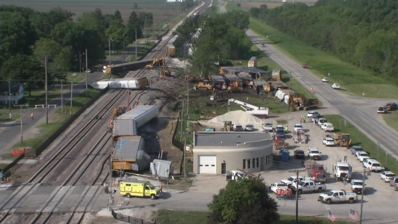 The train that derailed had new vehicles on board, with two of its rail cars carrying some hazardous chemicals. (Photojournalist Shawn Shanle)