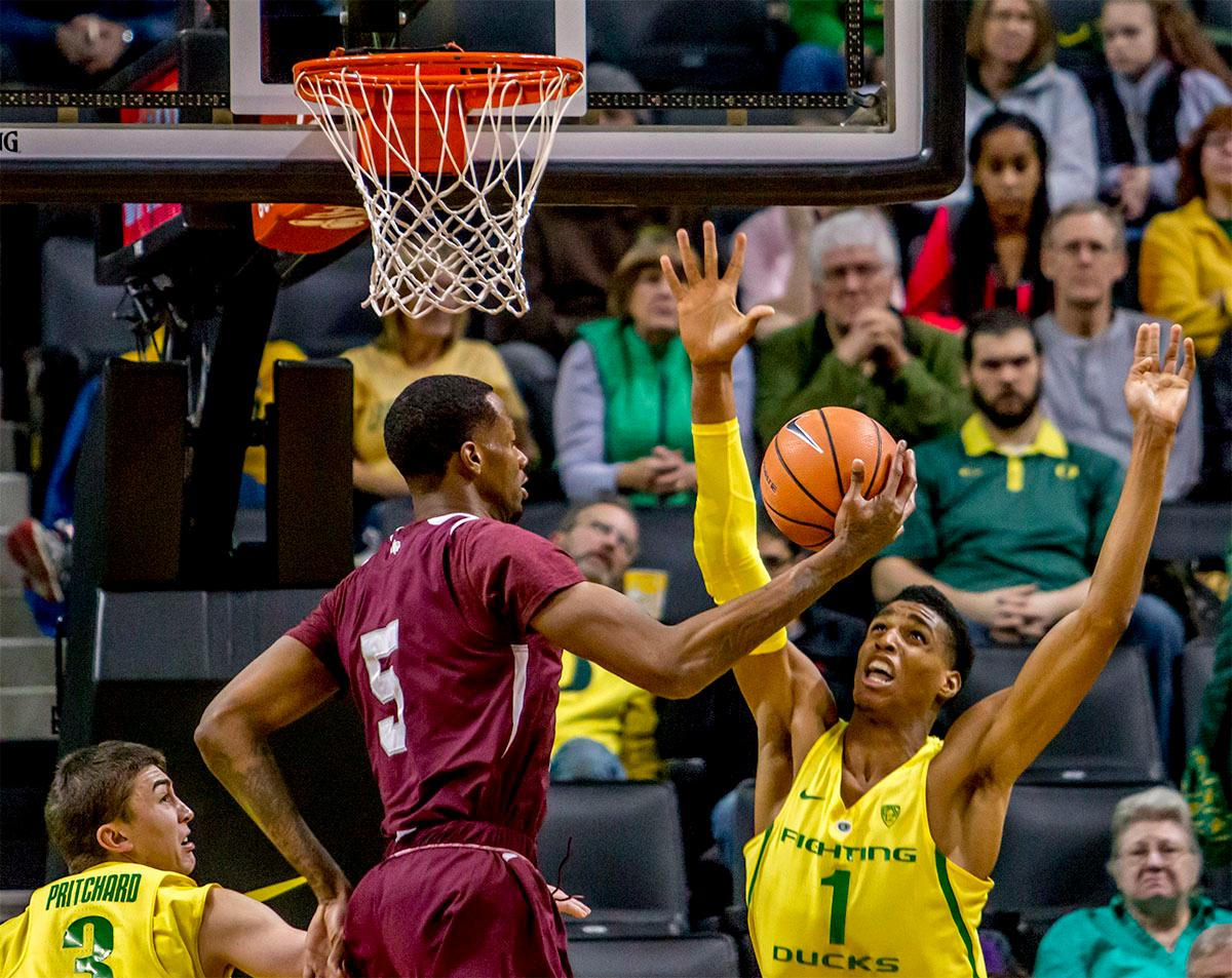 The Duck's Kenny Wooten (#1) attempts to block the Tiger's Trayvon Reed's (#5) shot. The Oregon Ducks defeated Texas Southern Tigers 74-68. The Ducks are now 7-3 overall in the Pac-12. Photo by August Frank. Oregon News Lab