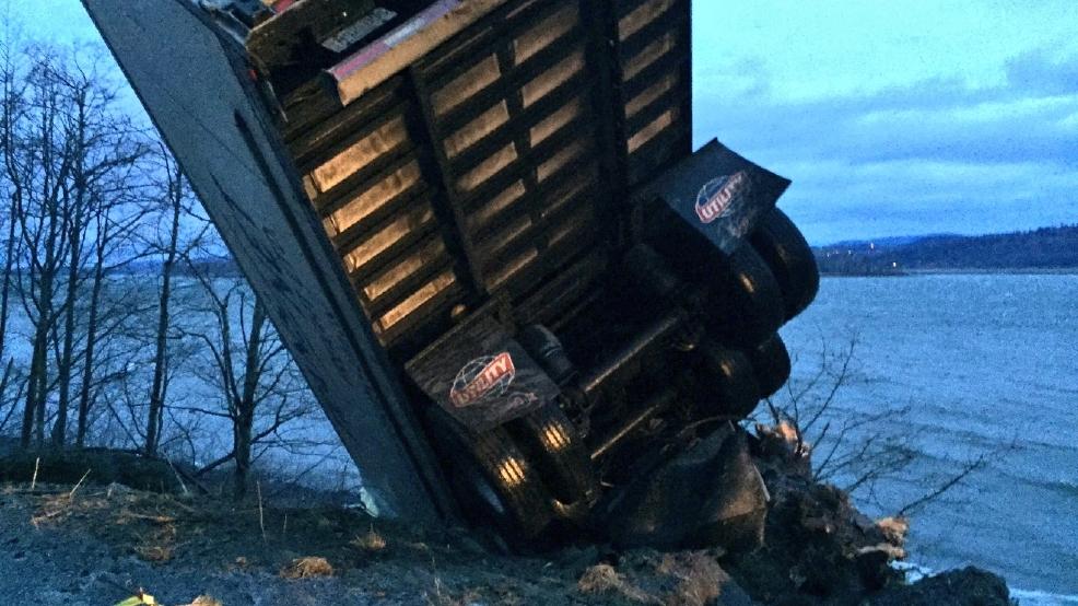 Semi slides through gorge highway guard rail tips off