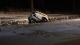 Driver found under ice near submerged car