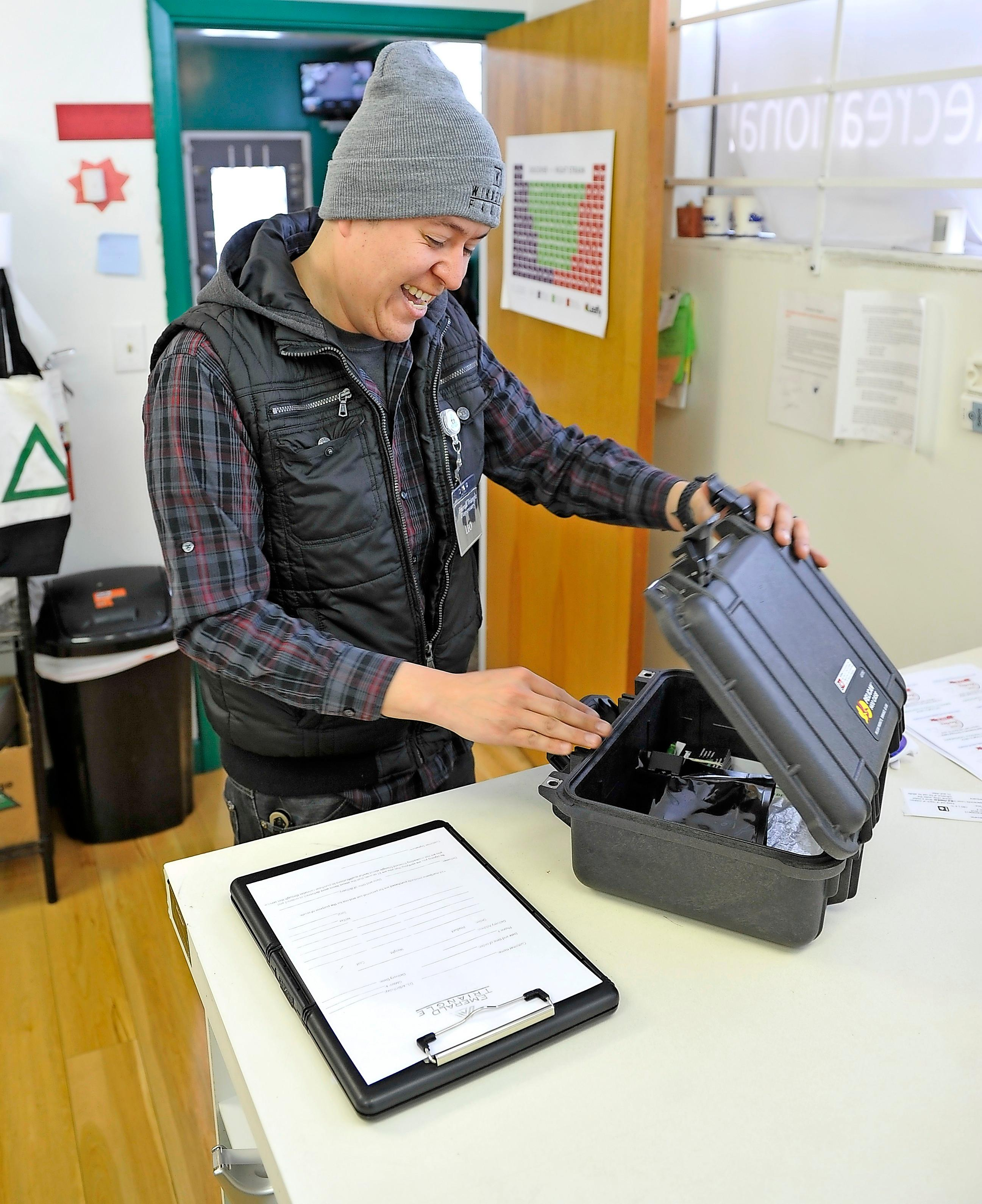 Leo Silva, bud tender at Emerald Triangle Dispensary in Medford, prepares for a delivery. - JAMIE LUSCH / MAIL TRIBUNE
