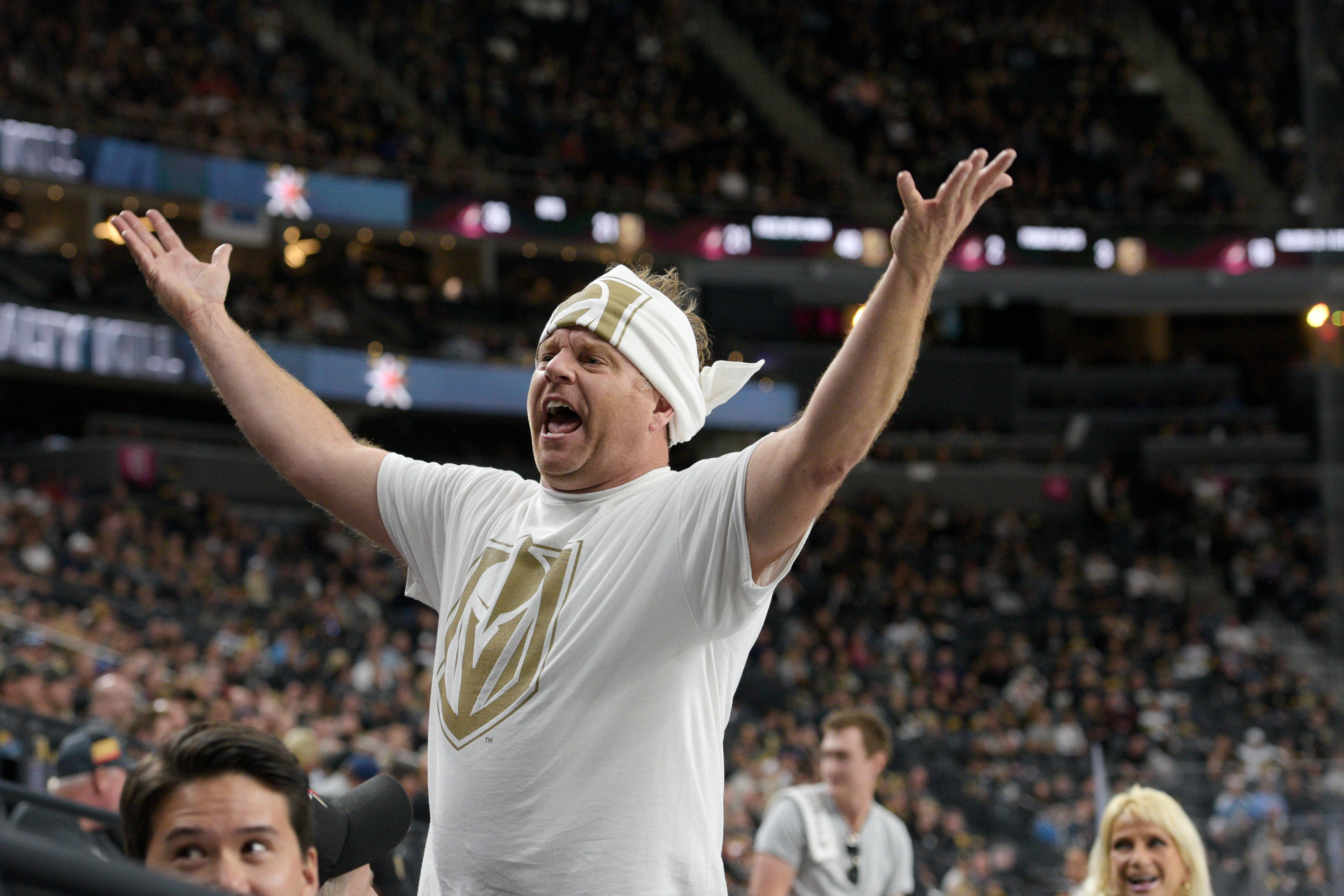 A member of the Las Vegas Golden Knights promotions crew gets the crowd to stand up during the Knights home opener Tuesday, Oct. 10, 2017, at the T-Mobile Arena. The Knights won 5-2 to extend their winning streak to 3-0. CREDIT: Sam Morris/Las Vegas News Bureau
