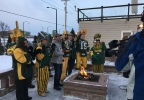 "Green Bay Packers fans cheer ""Go Pack Go"" to the beat of the Pulaski High School drumline Jan. 13, 2017, at the FOX 11 Field House."