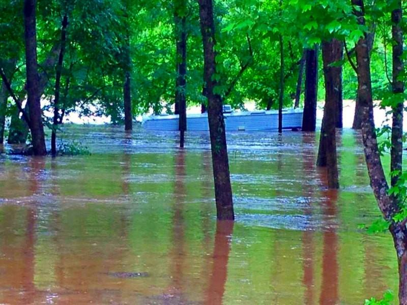 Camper almost completely underwater beside the Talapoosa River in Wadley, AL... photo from @endress_jsu