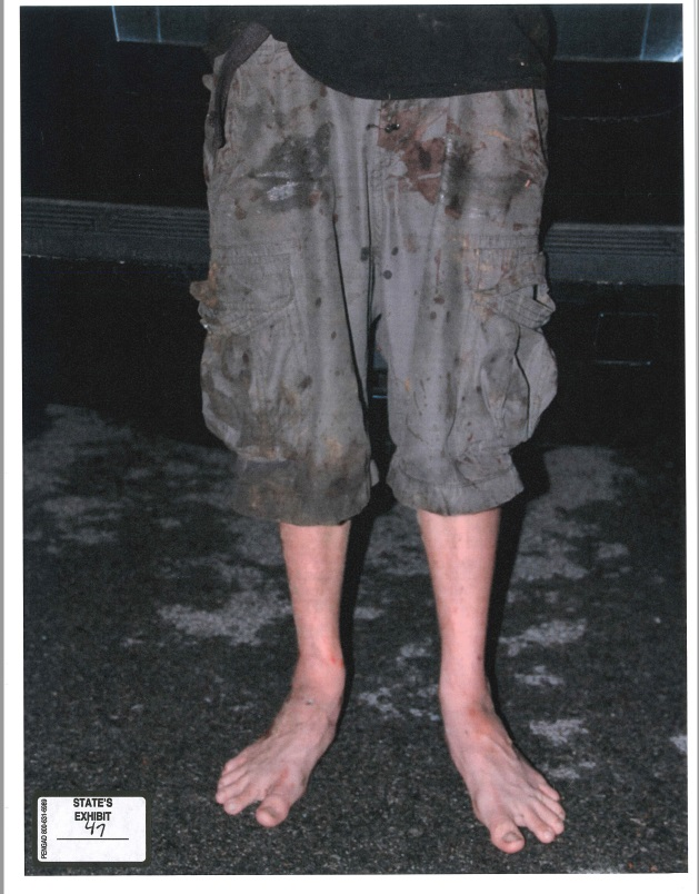 A photograph of Michael Bever's pants after his arrest for killing his parents and three siblings. (KTUL)