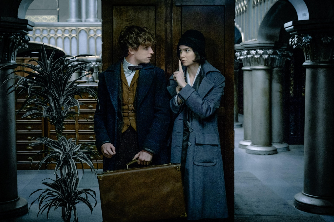 "EDDIE REDMAYNE as Newt Scamander and KATHERINE WATERSTON as Tina in Warner Bros. Pictures' fantasy adventure ""FANTASTIC BEASTS AND WHERE TO FIND THEM,"" a Warner Bros. Pictures release. (Jaap Buitendijk)"