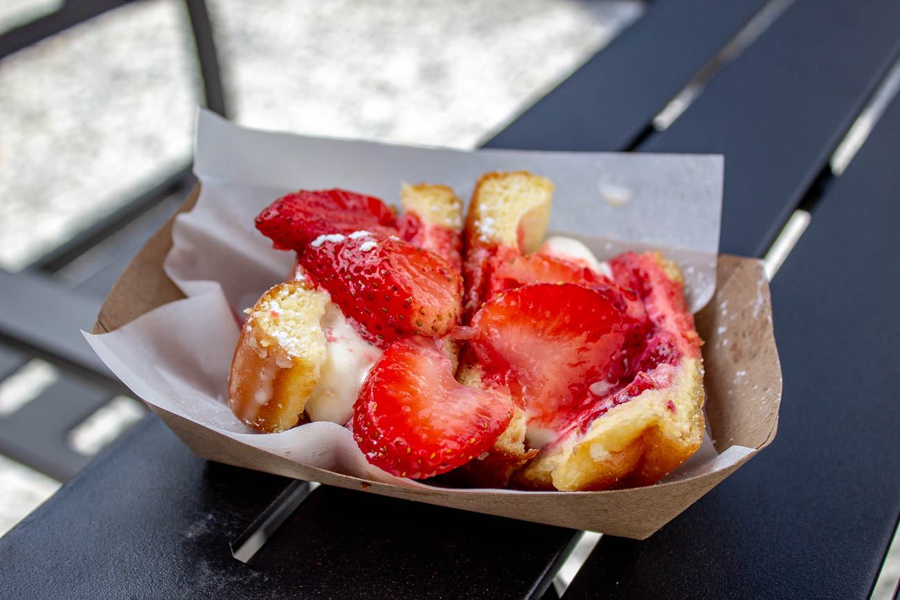 <p>Strawberries & Cream: vanilla ice cream stuffed into a glazed donut with fresh strawberries and powdered sugar / Image: Katie Robinson, Cincinnati Refined // Published: 7.21.19</p>