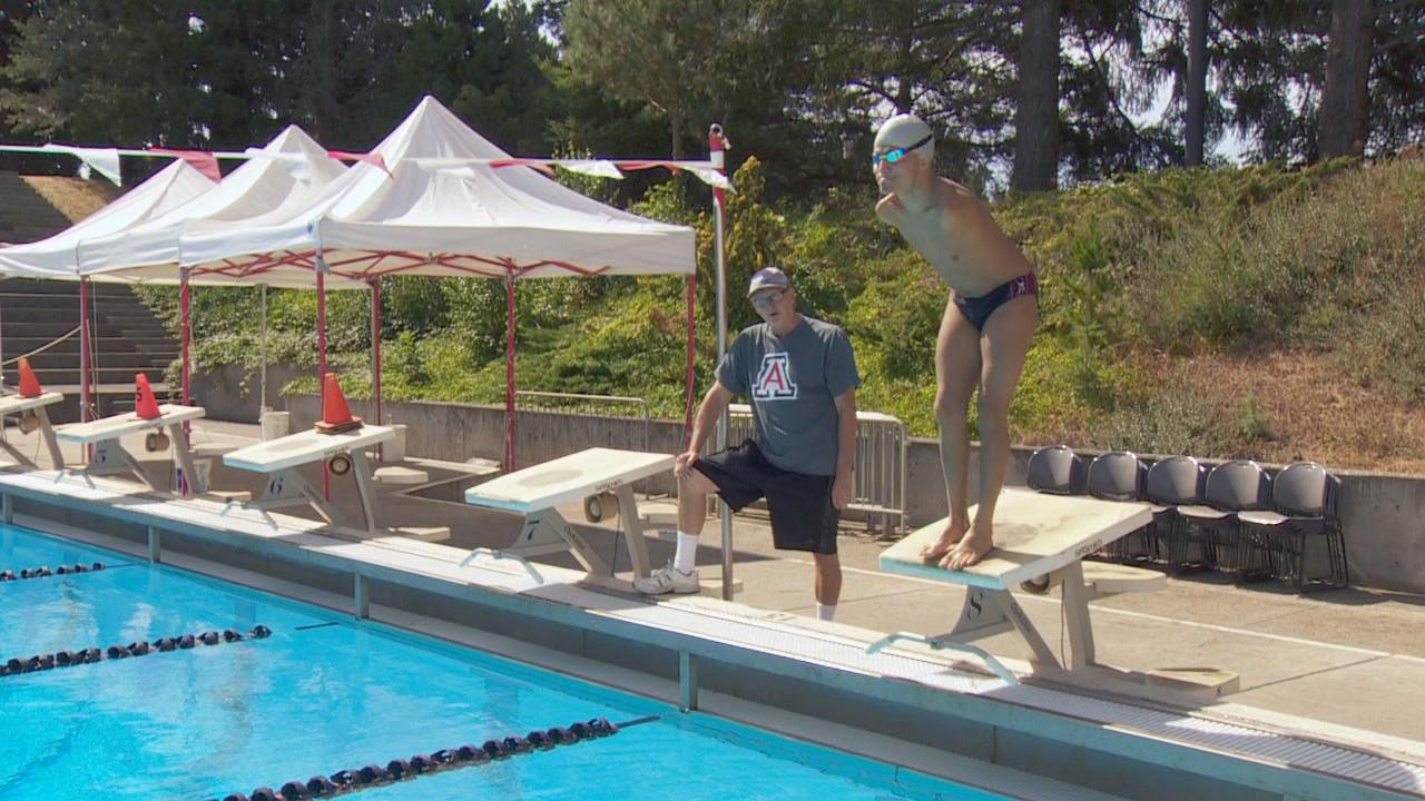 Abbas Karimi prepares to dive into the pool at Mt. Hood Community College as his coach Dennis Baker looks on. (KATU Photo)