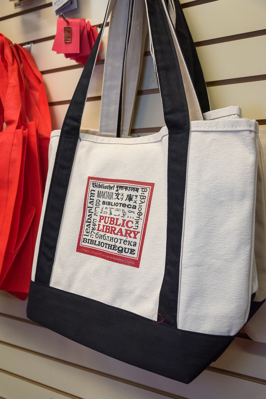 A tote bag with the original logo for the Library Friends' Shop. The shop opened in November of 1983. / Image: Phil Armstrong, Cincinnati Refined // Published: 12.13.18