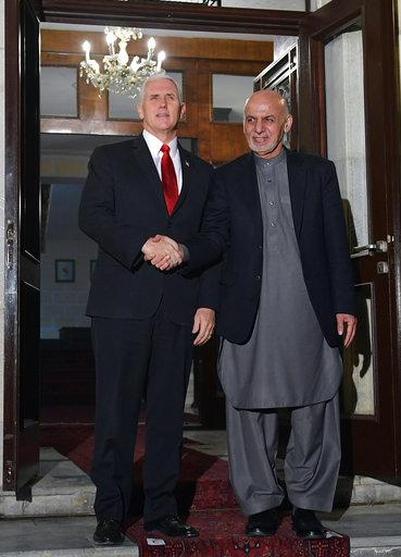 U.S. Vice President Mike Pence shakes hands with Afghan President Ashraf Ghani upon arrival at the President Palace in Kabul, Afghanistan, on Thursday, Dec. 21, 2017. (Mandel Ngan/Pool via AP)