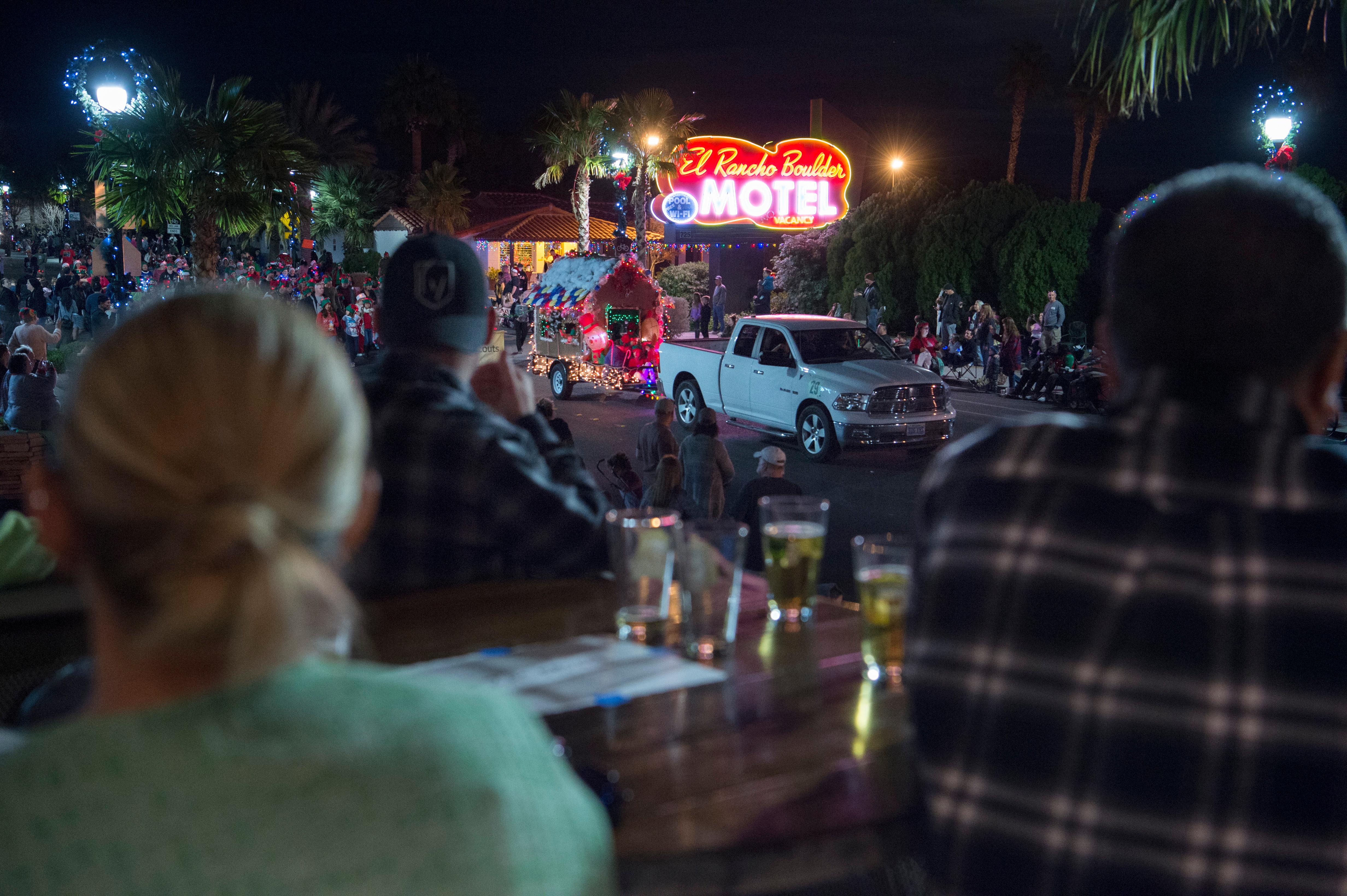 People watch Santa's Electric Parade from the patio of a bar and grill Saturday, December 2, 2017, in Boulder City. [Sam Morris/Las Vegas News Bureau]