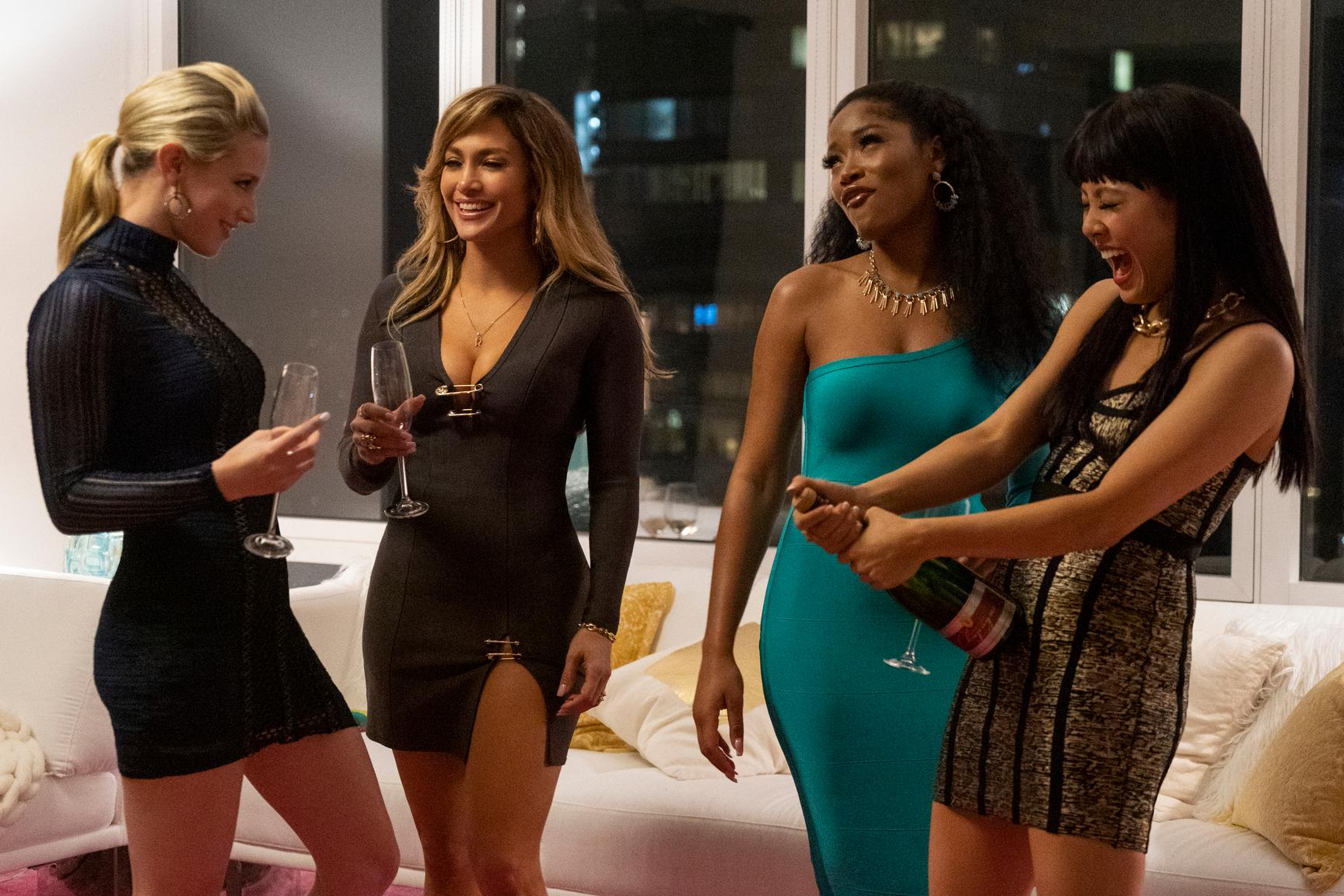 "This image released by STXfilms shows Lili Reinhart, from left, Jennifer Lopez, Keke Palmer, and Constance Wu in a scene from ""Hustlers."" The film will premiere at the Toronto International Film Festival in September. (STXfilms via AP)"