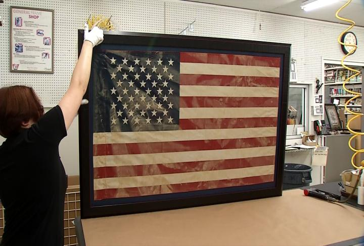 Eyewitness News and Michaels teamed up to frame Marie Clark's mud-covered American glag. She wanted to keep it as a sign of her family's perseverance. (WCHS/WVAH)