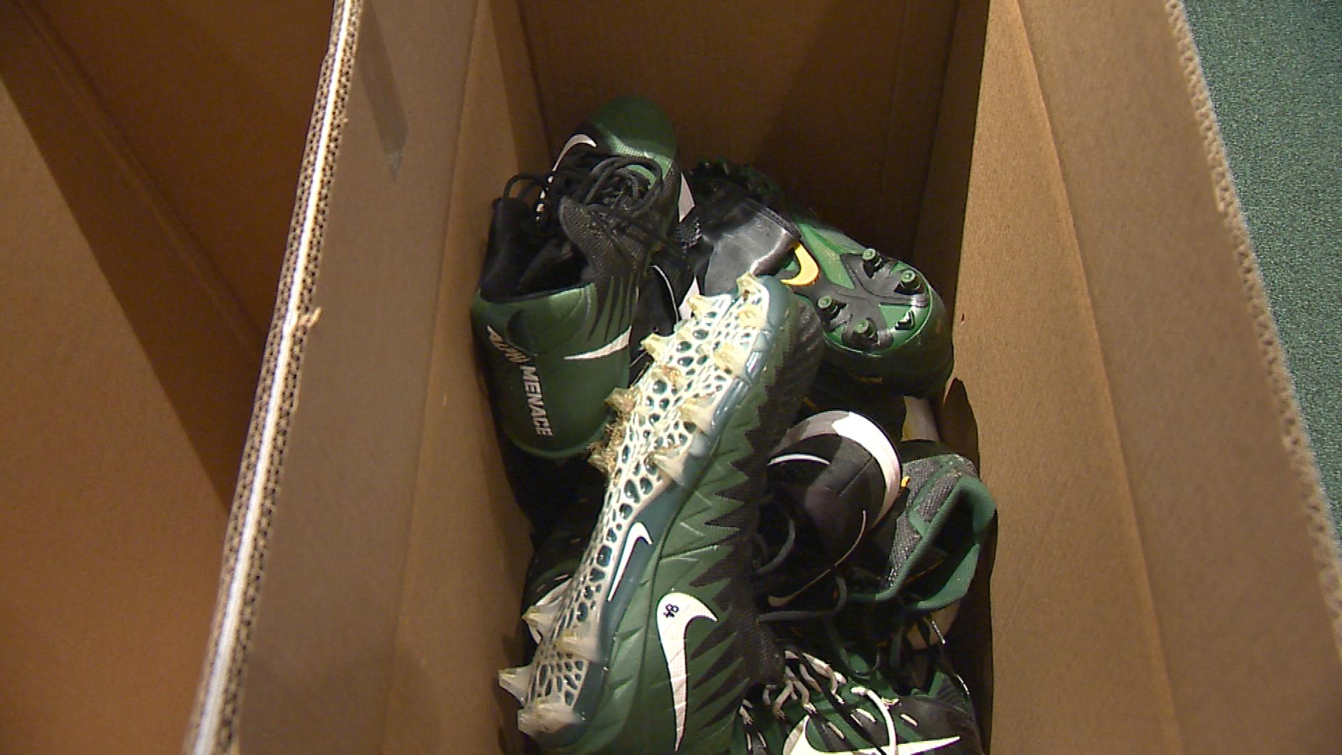 Green Bay Packers players donate their cleats at Lambeau Field Jan. 2, 2018. (WLUK image)<p></p>