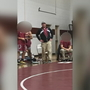 Owen High wrestling coach fights for his job