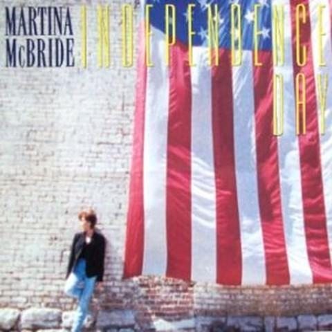 May not necessarily be patriotic, but it uses the holiday as a backdrop for change.http://www.vevo.com/watch/martina-mcbride/independence-day/USRV50100014