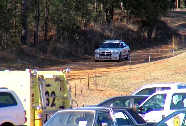 Law enforcement in Midland City, Ala. on January 31, 2013 during a hostage standoff with the man suspected of shooting and killing a school bus driver in Dale County before kidnapping a child.
