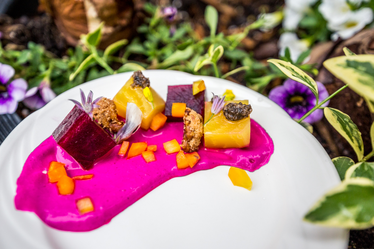 Beet Gateau: colored beets, goat cheese, walnuts, edible flowers, sprouts, black truffles, and bell peppers / Image: Catherine Viox{ }// Published: 6.18.19