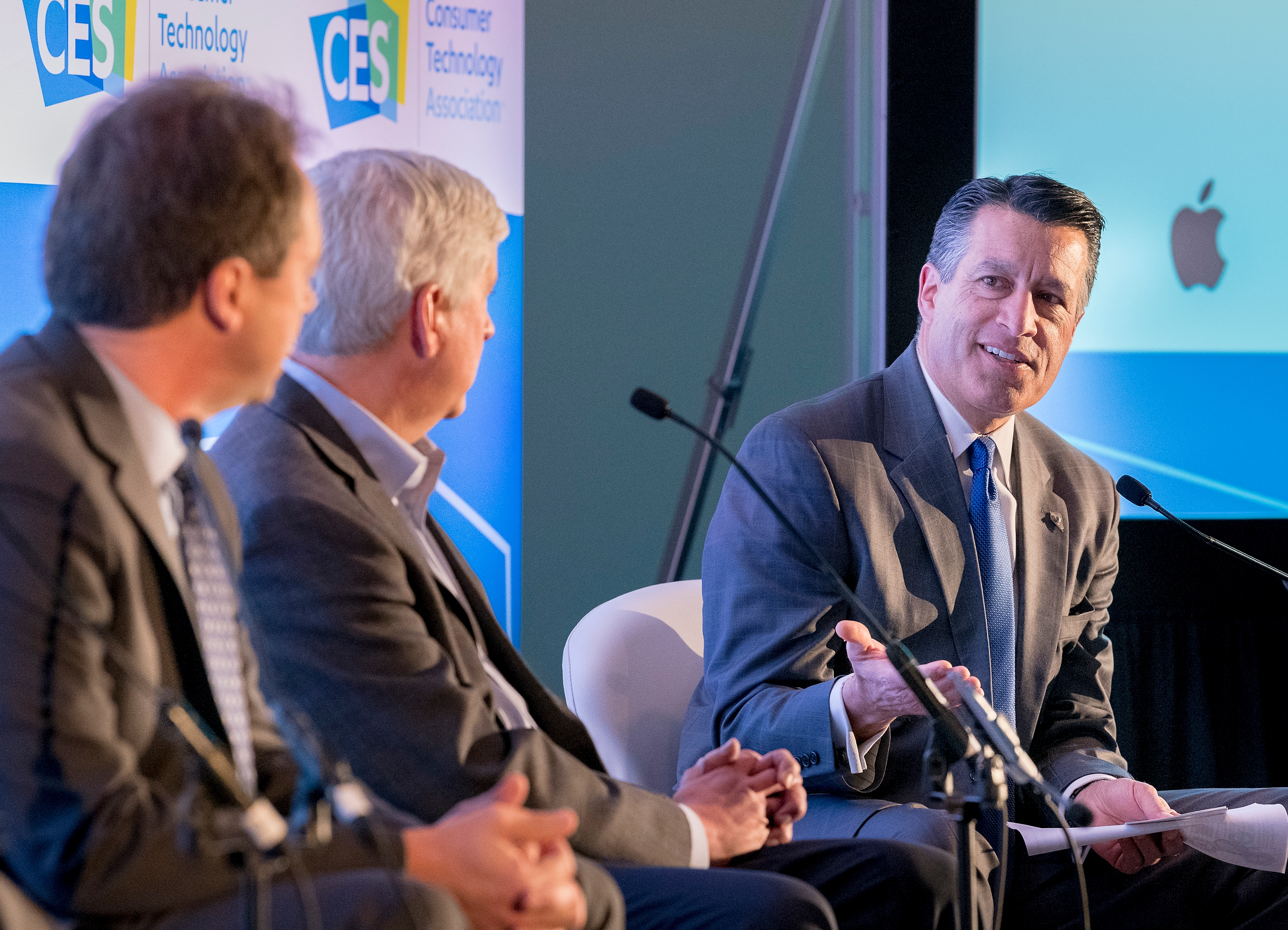 "Nevada Governor Brian Sandoval, right, makes a point during a panel discussion ""How States Can Become Innovation Leaders"" with Montana Governor Steve Bullock, left, and Michigan Governor Rick Snyder during CES at the Las Vegas Convention Center on Thursday, Jan. 11, 2018. CREDIT: Mark Damon/Las Vegas News Bureau"