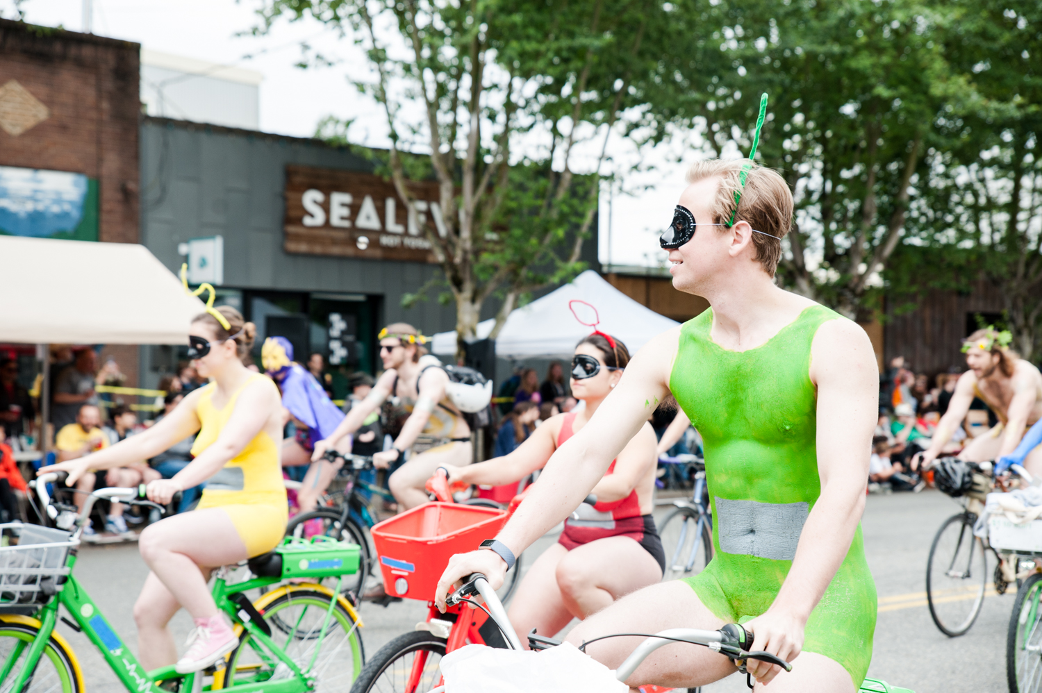 Tens of thousands came down to the Fremont neighborhood in Seattle, WA to watch the annual Solstice Parade. The parade is part of the Fremont Fair and celebrates the Summer Solstice. Hundreds of naked bike riders painted in unique ways unofficially start the parade each year, followed by musicians, dancers, clowns and other quirky characters. (Elizabeth Crook / Seattle Refined)