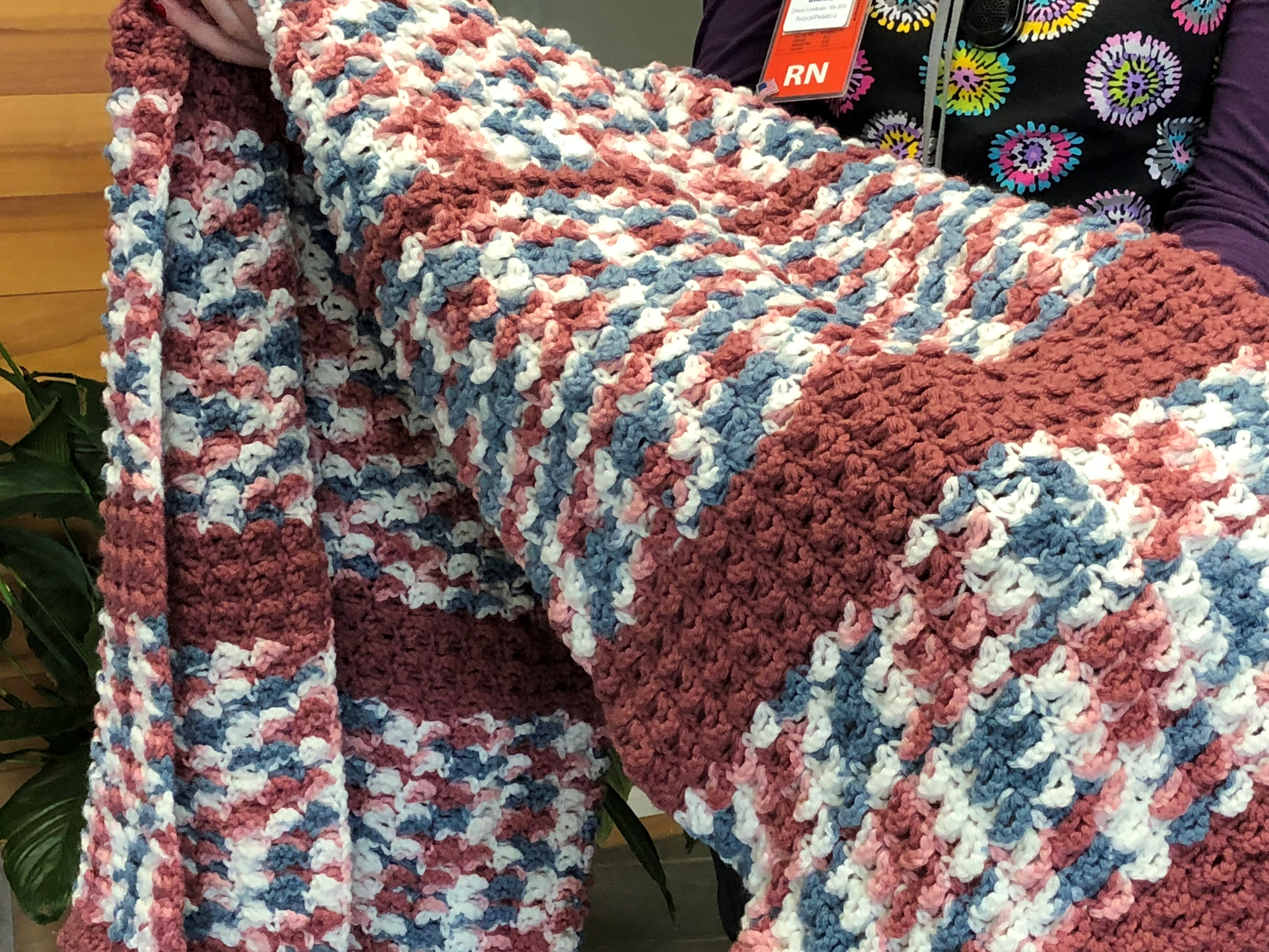 <p>People from around the world send individual squares to a Sutherlin woman who knits or crochets them into blankets for sick children. (SBG)</p>