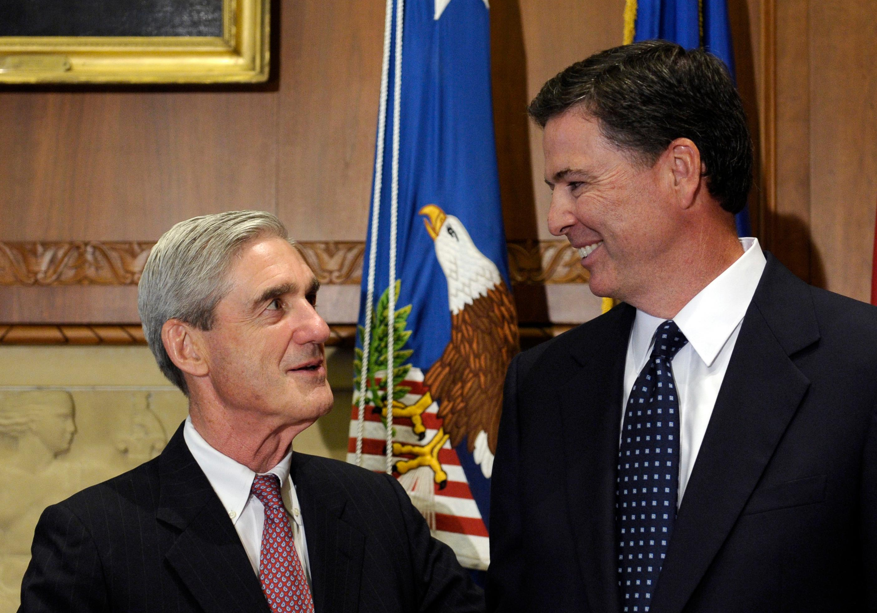 FILE - In this Sept. 4, 2013, file photo, then-incoming FBI Director James Comey talks with outgoing FBI Director Robert Mueller before Comey was officially sworn in at the Justice Department in Washington.  On May 17, 2017, the Justice Department said is appointing Mueller as special counsel to oversee investigation into Russian interference in the 2016 presidential election. (AP Photo/Susan Walsh, File)